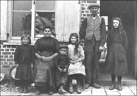 Old photo of worker family.